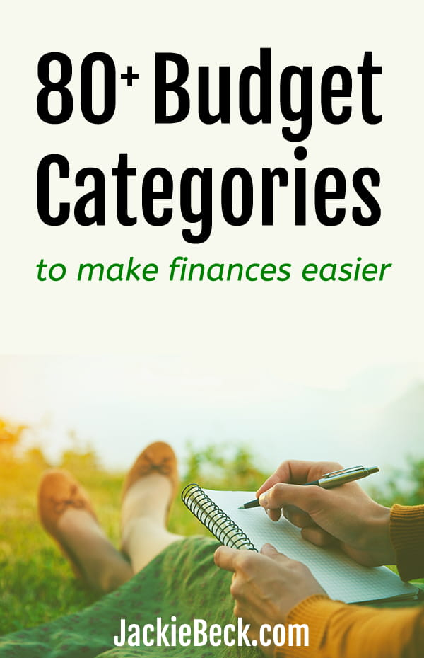 80+ budget categories to make finances easier - woman writing a budget while sitting in the grass