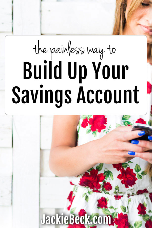 The painless way to build up your savings account with woman holding a cell phone